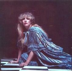 Stevie wearing a blue dress, posing on the checker floor (from The Other Side of the Mirror).