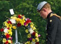 Prince Harry wearing his No. 1 ceremonial uniform of The Blues and Royals along with Major General Michael Linnington arrive to lay a wreath as they pays their respects to the victims of the Afghanistan conflict and the tomb of the unknown soldier during the second day of his visit to the United States at Arlington National Cemetery on 10 May 2013