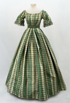 """Plaid taffeta dresses were almost a fashion uniform in the 1850s-1860s.  The dress was styled to be worn as shown in the picture; or else with button-on lower sleeves."