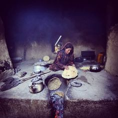 A young Wakhi Woman prepares bread in her Home in Afghanistan's incredibly remote Wakhan Corridor, where the diet consists mainly of goat meat and bread.