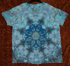 Tie dye I created for a friend. This is a mandala fold and the technique used was ice dye.