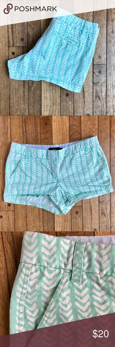 """J. Crew light teal patterned chino 2.5"""" shorts Excellent condition. No flaws to note, other than very minor wash wear. J. Crew Chino Shorts.  Light teal and cream arrow-like pattern.  Front Zip and slide closure.  Pockets in front and back.  Approximate measurements taken with garment laying flat: waist 34"""", hips 42"""", rise 8"""", inseam 2.5"""" J. Crew Shorts"""