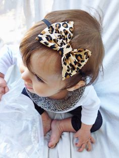 For all of her 3t and 4t cheetah outfits. Cheetah baby bow headband by turbansfortots on Etsy, $6.50