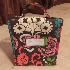 Beautiful Vera Bradley Lunch Bag It has a handle on the top an a name tag on the back.   It has a little poke mark and a little yellowish inside. It also has a snap front closure. Great lunch bag. Vera Bradley Bags