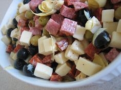 Antipasto Salad  1/2 lb. hard salami, cubed 1/2 lb. pepperoni, cubed 1/2 lb. mozzarella cheese, cubed 1/2 lb. provolone cheese, cubed Small can artichoke hearts, quartered Jar medium-sized green olives, drained Can of large black olives, drained Good Seasons Italian salad dressing (about 1/3 cup)  Combine all ingredients and let sit for at least 1 hour before serving to allow flavors to combine.