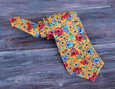 Boys Orange Floral Cotton Necktie, neck tie in infant, toddler, or child sizes, pre-tied and adjustable - pinned by pin4etsy.com