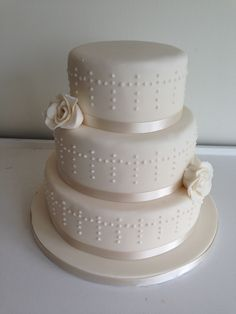 Classic three tier wedding cake with detailed pipework