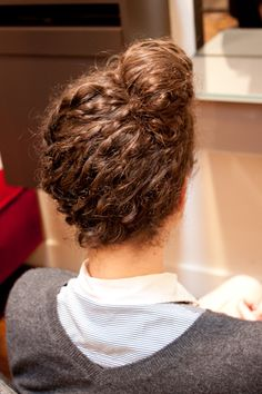 3 Awesome DIY Updos For Super-Curly Hair #refinery29  http://www.refinery29.com/20594#slide10  Top Knot!