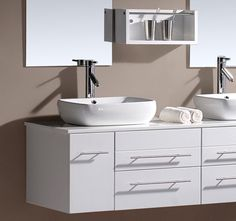White floating vanity with vessel sinks