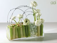 White flower arrangement ~ Designed by John Hosek Products by Accent Decor