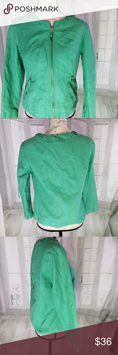 """Chico's Size 1 Medium Green Blazer Has an interesting nylon type of texture to it. A Chico's size 1 equals a Medium Size 8 in conventional sizes. 23"""" long, 23"""" sleeve, 20"""" armpit to armpit. Hand wash. Used but good condition. Shoulder pads. Lined in polyester. Made out of cotton, nylon, and metal fiber. Chico's Jackets & Coats Blazers"""