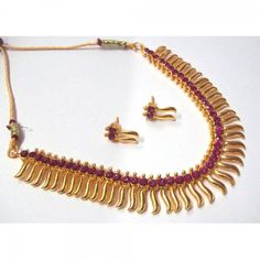 Buy Dark Pink Stone Golden Zigzak Necklace Set Online at cheap prices from Shopkio.com: India`s best online shoping site