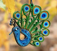 paper quilled peacock ornament or jewelry