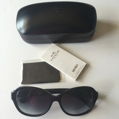 New authentic Coach sunglasses Brand new with case and cleaning cloth. Black frame with round gold coach logo. Coach Accessories Glasses