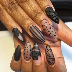 Stiletto nails with sheer black design