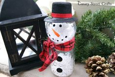 Mason Jar Snowman - Make an adorable snowman using a clear ornament and a mason jar.  Then have fun decorating it however you want! We starte…