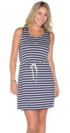 """Between the Lines Dress So cute, so comfortable, so stylish! The Between the Lines Dress has a fun hood, adjustable drawstring waist and classic stripes. Layer your favourite denim jacket on top or wear it on its own, this dress is the epitome of casual style.  Model is wearing S Hooded dress Adjustable drawstring Waist Approx 34"""" long (size S) 95% Rayon 5% Spandex Made in the USA Silver Icing Exclusive"""