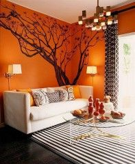 Orange Living Room Decorating Trend | Orange walls, Chair pillow and ...