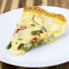 This veggie quiche is loaded with the freshest spring produce. It's a perfect make-ahead meal for breakfast, brunch or dinner! It's time for What's Baking! This round is hosted by Liz of Books and Cooks, and thetheme is quiche. I love quiche — it's very versatile, and can be served at any meal. It's a... Healthy Eating Recipes, Healthy Breakfast Recipes, Brunch Recipes, Breakfast Meals, Vegetarian Quiche, Vegetable Quiche, Make Ahead Meals, Easy Family Meals, Ham And Cheese Quiche