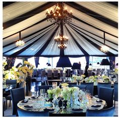 Black and White...incredible marquee and table designs. This is a perfectly styled wedding!! Love the black chandeliers and the lamps on the tables - ties in together so well!!