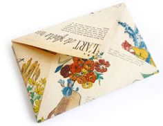 Make pretty envelopes out of old/vintage magazines. Use an old plain envelope for a template, and use thin double sided tape on the flaps (for sealing) of your pretty new  ones.