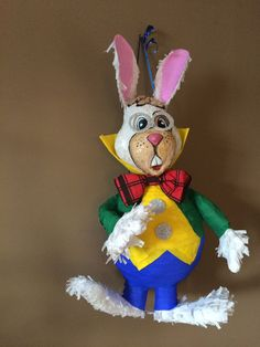 Pinata Rabbit is made from paper mâché decorated with crepe paper . We are filling Pinata with confetti only,on back of rabbit is small door thought were you can put sweets inside. The best time to order Pinata would be 4-5 weeks before because we need to calculate on delivery time. For further info .feel free to contact us any time.