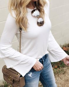 #winter #outfits white top, jeans, brown bag