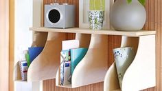 magazine holders hung on the wall (upside down) for mail & other junk via http://homes.ninemsn.com.au/diy/homeimprovement/8209721/mail-station