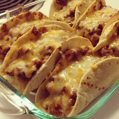 Oven baked tacos.  Spray cooking spray.  Then add tortilla, refried beans,  hamburger meat, & cheese.  Cook at 375 degrees for about 10 minutes.  Optional..add cold ingredients on top if desired.