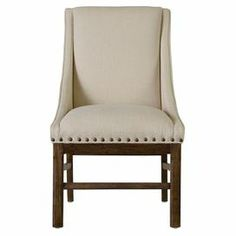"Upholstered accent chair with nailhead trim and exposed wood legs.    Product: Chair    Construction Material: Solid hardwood and fabric   Color: Whiskey barrel and cream   Features:Nailhead trimExposed legs   Dimensions: 39"" H x 23"" W x 25"" D"