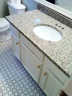 Bath Reno With American Olean Sausilto Ceramic Hex Tile And Luna Pearl  Granite.