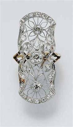Diamond filigree ring, circa 1905  Visit doylenewyork.com