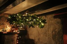 wreath chandelier // diy with greenery + hula hoop // hung from dinner tent + dancing tent
