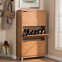12 brilliant shoe storage ideas that will keep your footwear organized - shoe cabinet. This stylish shoe cabinet takes up minimal space, but has room for 18 pair of shoes Shoe Storage Design, Wooden Shoe Storage, Shoe Storage Solutions, Shoe Storage Cabinet, Rack Design, Storage Ideas, Storage Rack, Front Door Shoe Storage, Bathroom Storage