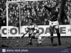 15th January 1974. Chelsea's Ron Harris accuses QPR forward Stan Bowles of diving during a bad tempered game FA Cup replay at Loftus Road.