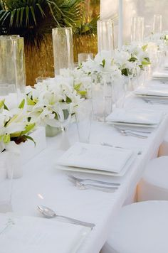 Be bold! Go for an all white color palette and accent with beautiful white lilies and a touch of green.