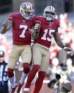 San Francisco 49ers quarterback Colin Kaepernick celebrates with wide receiver Michael Crabtree after they connected on a 49-yard touchdown