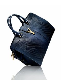Yves Saint Laurent Cabas Chyc Handbag  - rich blues and gold hardware. This bag is simply divine.