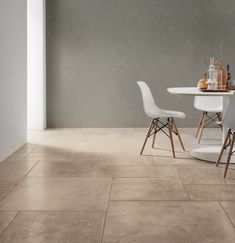 This contemporary dining area has stone look porcelain tile from the Carriere Du Kronos Collection. This tile comes in a variety of shapes and sizes and can be used for indoor and outdoor use. Ceramic Floor Tiles, Tile Floor, Porcelain Tiles, Living Room Flooring, Kitchen Flooring, Bruges, Flagstone Tile, Wood Effect Tiles, Tile Manufacturers