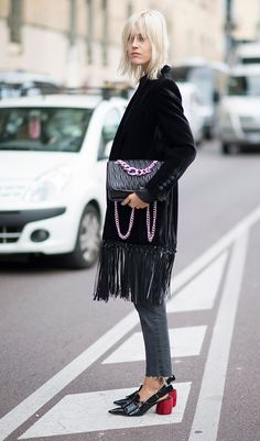 It's the little details that lift Linda Tol's ensemble at Milan Fashion Week. Check out the tassels of her velvet Blazé Milano jacket, her black quilted, chain-strap Miu Miu bag and the stunning scarlet block heels of her sling back shoes