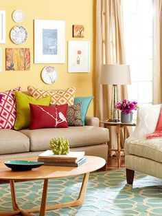 Cheerful living room, I like the way the colors work together. I also like the design of the coffee table.