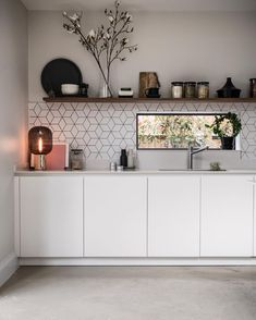 white matte kitchen with low level window Styling and photography by SHnordic