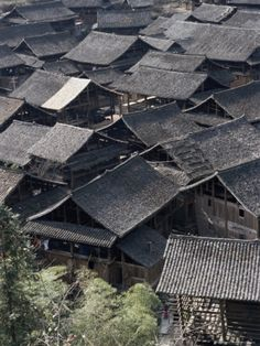 this is a dong village. i watched a documentary about these places a while back and basically singing is a huge part of their lives and its amazing, the women dress so ornately and the performances they do are so interesting. would love to go there.