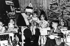1947: Babe Ruth is dressed as Santa Claus with 3 year old Jimmy McCall on his knee and Jane Greenfield at his side during a Christmas Party for 65 young Poliomyelitis victims given by the Sister Elizabeth Kenny Foundation in the Hotel Astor in New York City.
