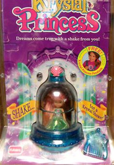 Krystal Princess was produced by Playskool in 1992. They were small dolls which came inside a snow-globe type dome which sat on a base. The dome contained liquid and various shaped glitter. Each doll also came with a skirt, crown and comb.