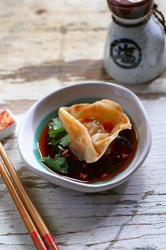 Sichuan Spicy Wontons recipe. Your regular Chinese wonton gets a spicy and fiercy red oil vinegar sauce. The end result is tantalizing. Learn how to make it with this easy and quick recipe!