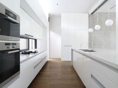 The cabinetry is all seamless without hardware on it. The white color pallet gives a very clean look.
