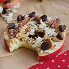 Cored apple slices with peanut butter, oats, nuts and chocolate chips