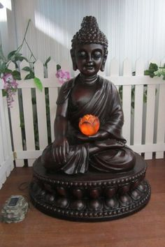 Solar Garden Buddha With Illuminating Lotus. Kit out your your garden with a little Zen! Lawn Ornaments, Product Offering, Solar Power, Lotus, Buddha, Statue, Lights, Garden, Zen