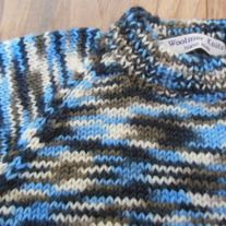 "100% pure new wool is sure to keep your tiny tot warm this winter. Knitted in  lovely multi colours and a double neck for extra warmth. Please check the measurements carefully. Chest: 19"" Length: 9.75 Underarm sleeve seem: 5.5"" Gentle machine or hand wash at 30 C. Short gentle spin or dry fla..."